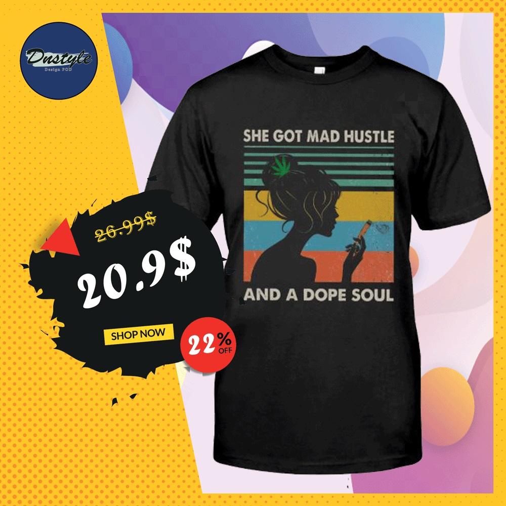 She got mad hustle and a dope soul vintage shirt
