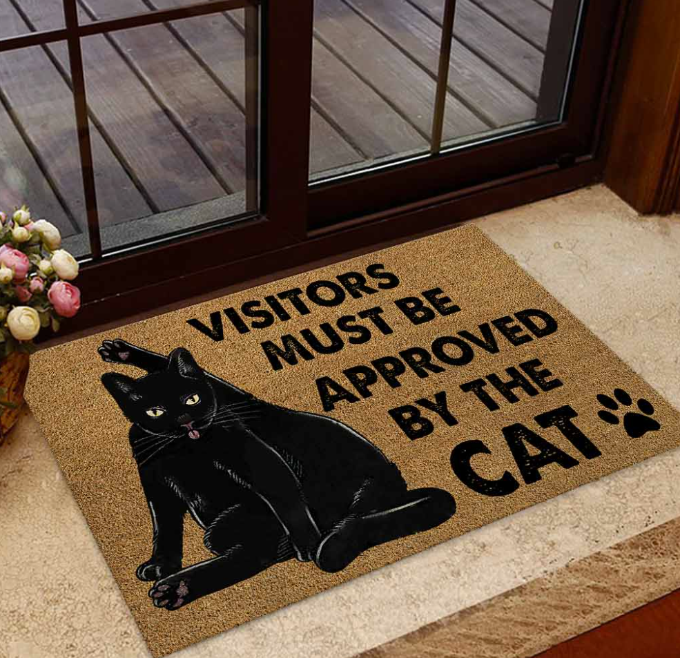 Black cat visitors must be approved by the cat doormat