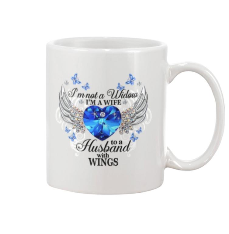 I'm not a widow i'm a wife to to a husband with wings mug