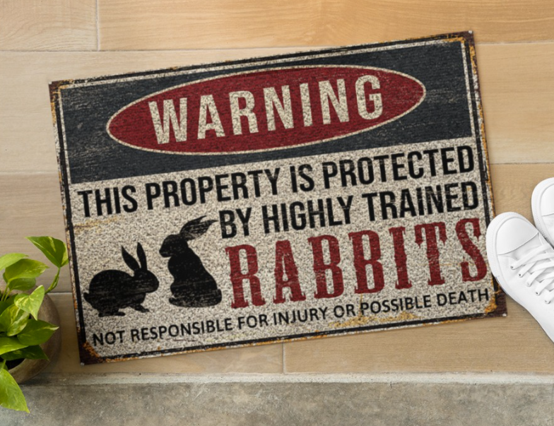 Warning this property is protected by highly trained rabbits doormat 1