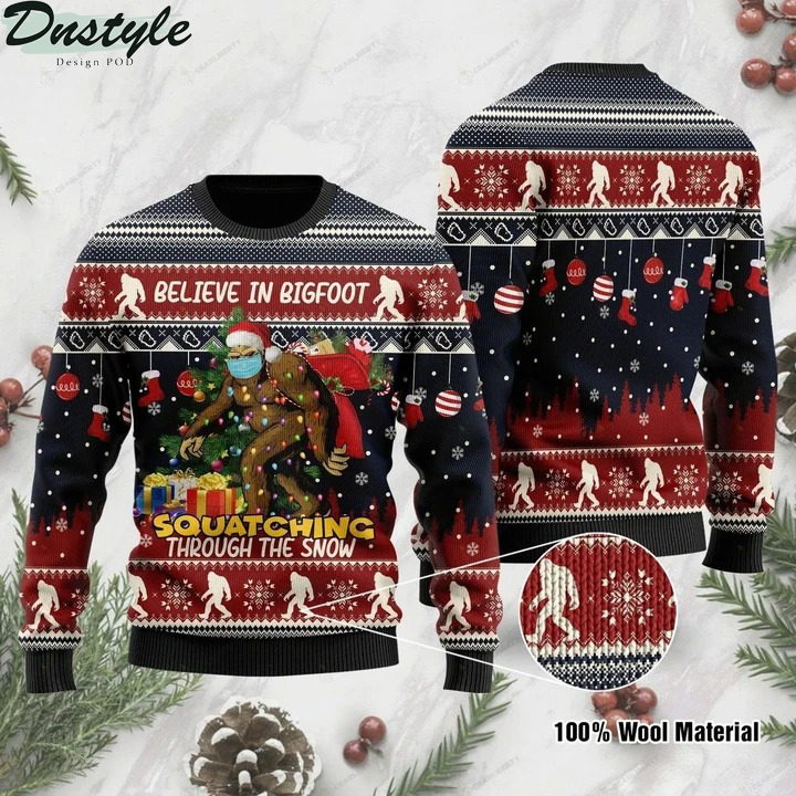 Believe in bigfoot squatching through the snow ugly christmas sweater