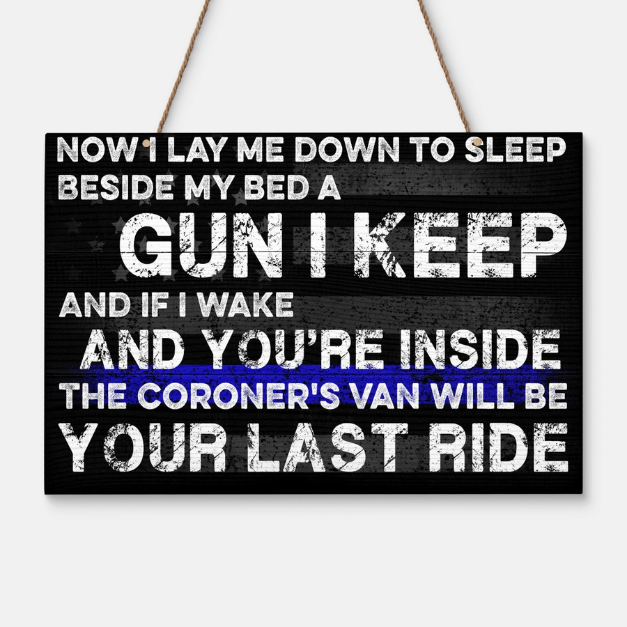 Now I lay me down to sleep beside my bed a gun I keep wooden sign 1