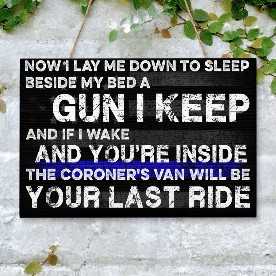 Now I lay me down to sleep beside my bed a gun I keep wooden sign 2