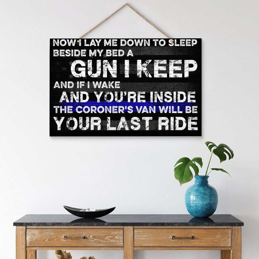 Now I lay me down to sleep beside my bed a gun I keep wooden sign 3